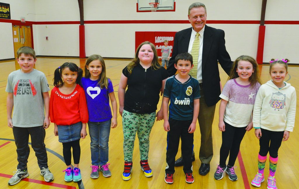 Mike Bowman, longtime principal of Lockwood Elementary School, spent time in PE with second graders on Tuesday. Students in Deb Carlson's class, they are, from left, Tyler Leinemann, Reese Griesmer, Audrey Rieker, Emerald Browning, Trask Wickens, McKensey Tininenko and Keelee Logan. (Judy Killen photo)